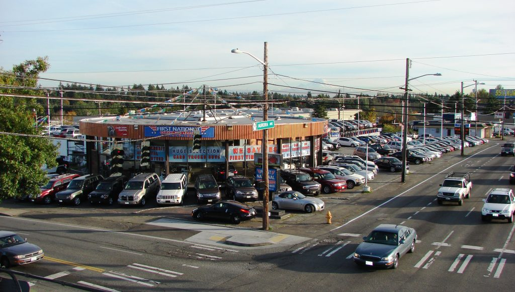 The former car dealership property has been purchased for the site of a new police station at 130th & Aurora in north Seattle.