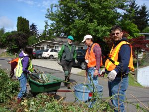 Many wheelbarrow loads of plant material were hauled away at Spring Clean.