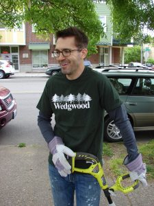 Tony Frego, president of the Wedgwood Community Council, whacked weeds for Spring Clean on April 23.