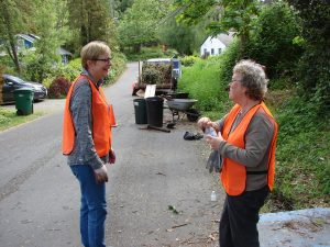 Spring Clean workers made fashion statements with orange vests.