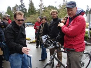 Clint Loper (at left) talks with Mayor McGinn about Clint's bike, as the mayor arrived in Wedgwood for a tour of the neighborhood in March 2012.