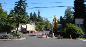 On the 38th Ave NE Greenway in Wedgwood, construction equipment is parked and ready for installing speed bumps.