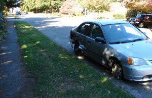 On the south side of NE 80th Street, tire tracks are visible and there is another side-swiped car, damaged on Sunday afternoon, September 25th.