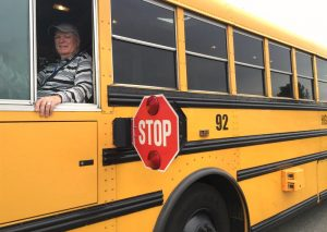 school bus with stop paddle