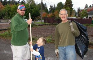 Park clean-up volunteers John and Tom plus one little guy.